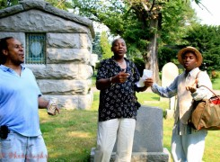 Morgan Powell, right, at Woodlawn Cemetery, during one of his many tours.